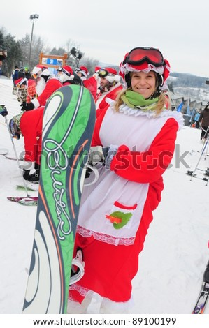 WINDHAM, NY -  DECEMBER 19: An unidentified snow boarder take to the slopes during the Skiing and Riding Santas charity at Windham Mountain in Windham, NY on December 19, 2010. Skiers must be in full Santa costume to participate and proceeds benefit the l