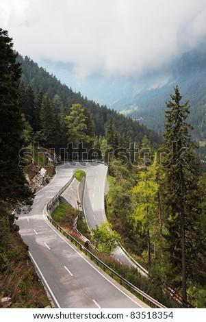 Winding and dangerous mountain road - Serpentine, lighted autumn sun. Photo taken by lens Fisheye