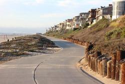Winding empty bike bath on the strand from Hermosa Beach to Manhattan Beach on a beautiful summer day.