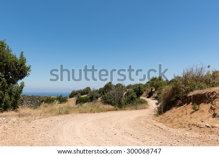 Winding mountain dirt road and foliage on Cyprus