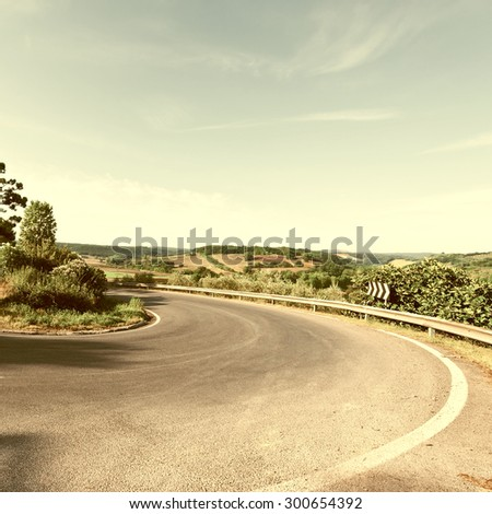 winding paved road in the...