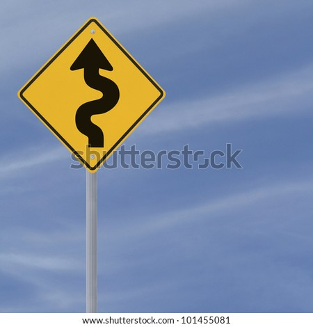 Winding road ahead sign on a blue sky background with copy space