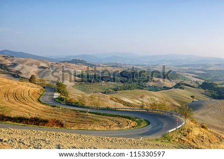 Winding road in autumn Tuscany, Italy
