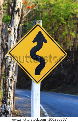 winding road sign in yellow and black