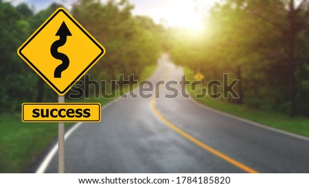 Winding road sign with success sign to the mountain in the middle of the forest with many trees. Concept for success in the future goal and passing time Photo stock ©