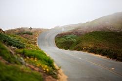 Winding road through the fog on the northern California coast
