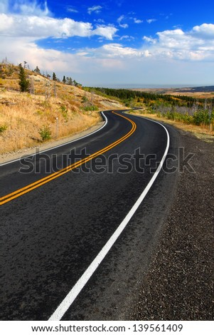 Winding road through the rural countryside of Glacier County Montana