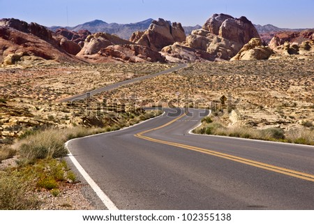 Winding road through unusual rock formations used to represent Mars in Star Trek shows at Valley of Fire in Nevada, USA - stock photo
