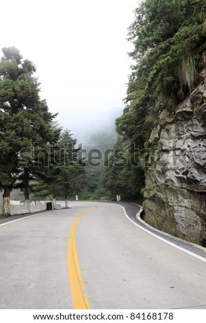 winding road with fog in the mountain