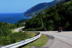 winding roads on cabot trail (cape breton island, canada) on cliffs overlooking the blue green Atlantic Ocean