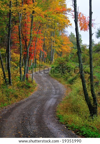 Winding rural mountain road in Autumn