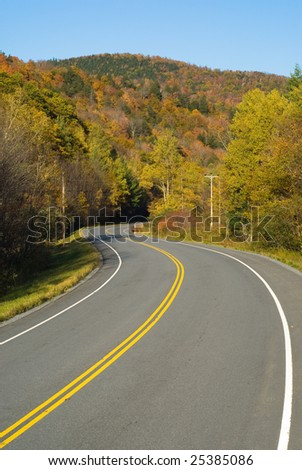 Winding scenic highway in a fall landscape