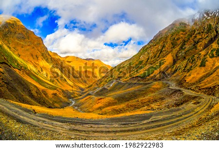 Winding trail through the mountain hills. Mountain winding trail Mountain landscape