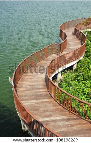 Winding Wooden Bridge Along The Coastline