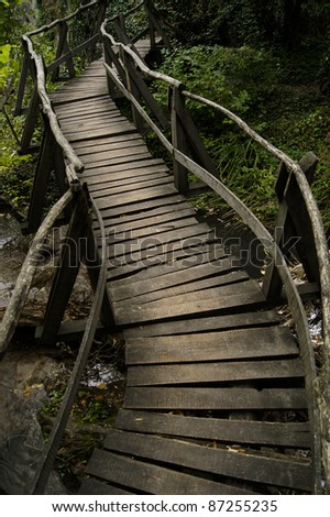 Winding wooden bridge over a river