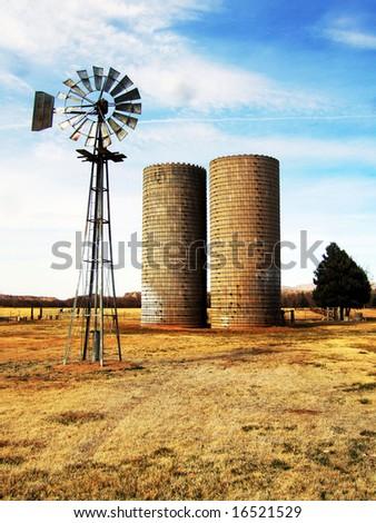 Windmill and Silos - stock photo