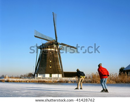 Windmill and skaters at the foreground