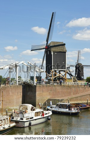 Windmill and wooden drawbridge in the fortress city of Heusden, province of Noord-Brabant, the Netherlands