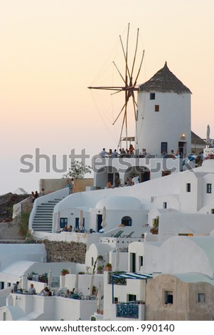 Windmill at sunset Oia Santorini Greece