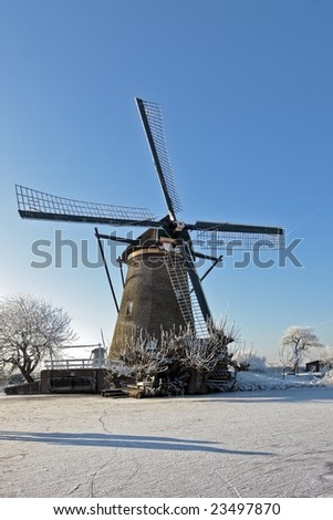 Windmill at the Kinderdijk in wintertime in the Netherlands