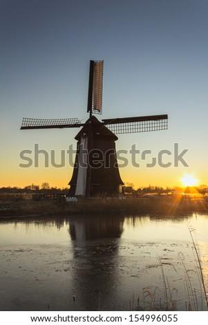 Stock Photo Windmill at the sunet in Alkmaar, Netherlands