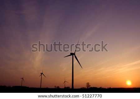Windmill conceptual image. Windmills in sundown.