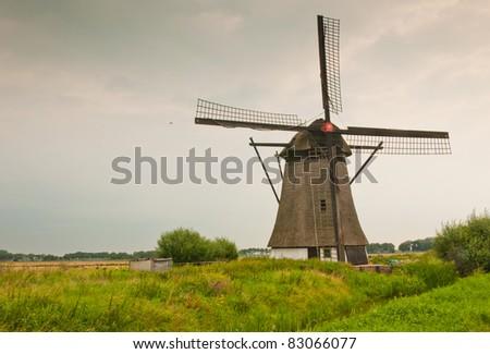 "Windmill ""De oude doorn"" (anno 1700) in the small Dutch village of Almkerk"