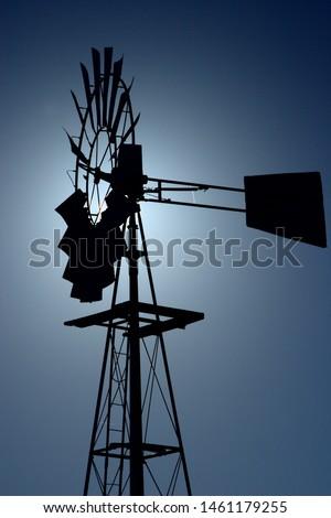 Windmill edged against the sun