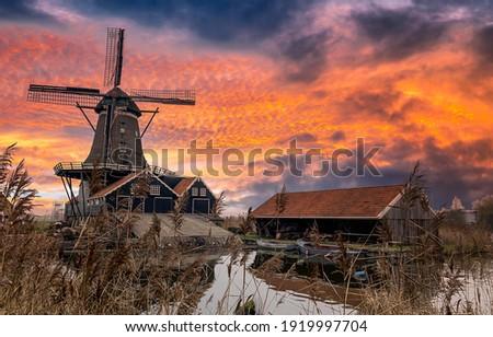 Windmill farm in morning sunrise. Sunrise windmill farm river. Windmill sunrise scene. Windmill sunrise view Сток-фото ©