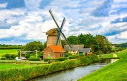 Windmill farm river landscape. Windmill dutch farm scene. Netherlands windmill farm view