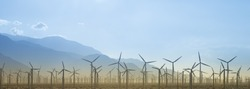 Windmill Farm Silhouette With Mountains
