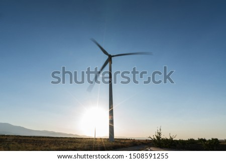 windmill field generating clean energy at full capacity, energy concept #1508591255