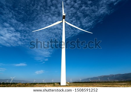 windmill field generating clean energy, energy concept