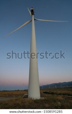 windmill field generating clean energy,energy concept