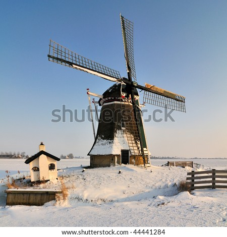 Windmill in Dutch winter landscape