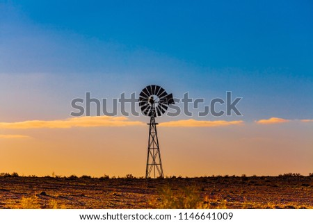 Windmill in South Australia at sunset #1146641009