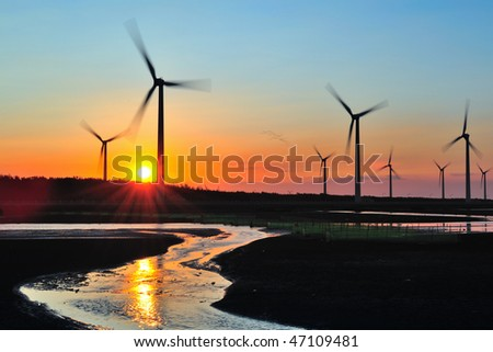 windmill in sunset at seacoast