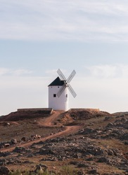 windmill in the countryside with red earth and blue sky castile la mancha don quixote europe spain