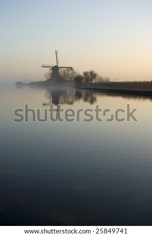 Windmill in the foggy morning