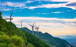 Windmill in the rainy season in the missing mountain in Heyuan, Guangdong, China