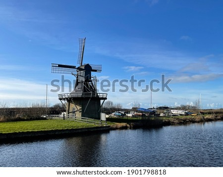 Windmill next to a canal in Joure Friesland The Netherlands Photo stock ©