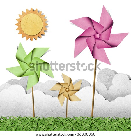 windmill on grass field recycled papercraft  background