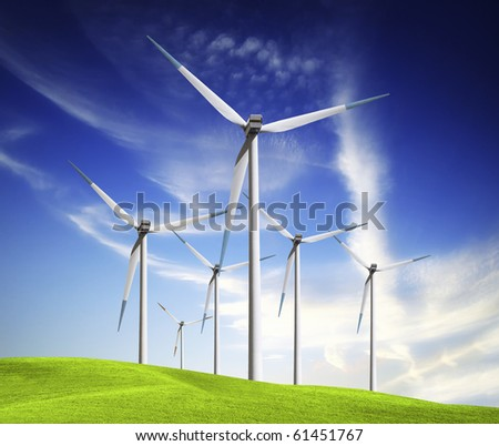 Windmill on green field