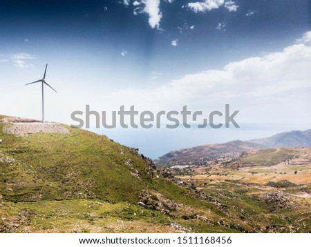 Windmill on mountain against sky with scenic landscape #1511168456