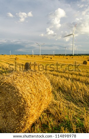Windmill on the field with stubble
