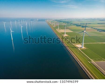 Windmill park offshore and onshore in the Netherlands, huge windmill farm at the Noordoostpolder Flevoland