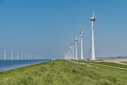Windmill park Westermeerwind the largest wind farm offshore and on land in theNetherlands.The wind farm produce 1.4 TWh of electricity, enough electricity to over 400,000 households.Urk,Netherlands