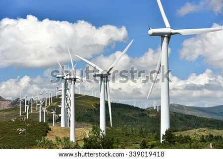 windmill-powered plant on hilltop in Europe