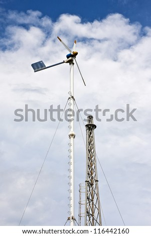 Windmill producing alternative energy with a cloudy sky