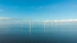 Windmill row of windmills in the ocean by the lake Ijsselmeer Netherlands, renewable energy windmill farm Flevoland